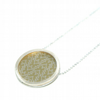 Silver and pale gold circle necklace - butterfly pattern