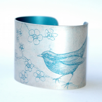 Blackbird and blossom anodised aluminium cuff - teal