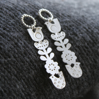 Silver totem flower and bird drop earrings