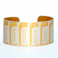Geometric penguin print aluminium cuff orange
