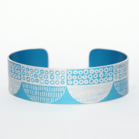 Seed head pattern aluminium cuff blue