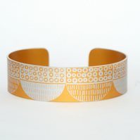 Seed head pattern aluminium cuff orange
