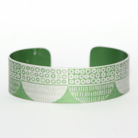 Seed head pattern aluminium cuff green
