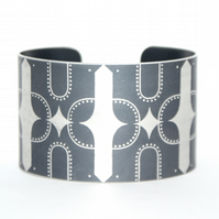 Geometric bird print aluminium cuff dark grey