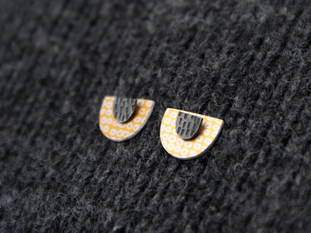 Gold and black semi-circle studs