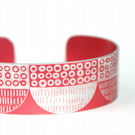 Seed head pattern aluminium cuff red