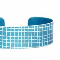 Dark blue criss cross aluminium cuff