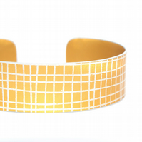 Mustard yellow criss cross aluminium cuff