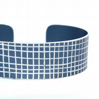Dark grey criss cross aluminium cuff