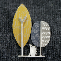 Hedgehog and trees brooch