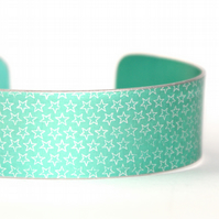 Geometric star pattern cuff bracelet soft green