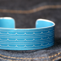 Wave pattern aluminium cuff blue