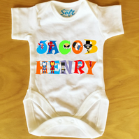 Baby Vest baby grow body suit with Personalised Super Heros Name font