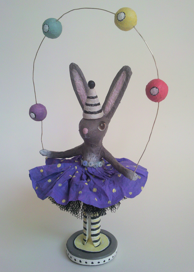 Highly-skilled Juggling Rabbit in a Blue Dress. Small sculpture