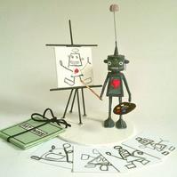 Robot amateur artist at summer school. Robot with removeable heart and brain.