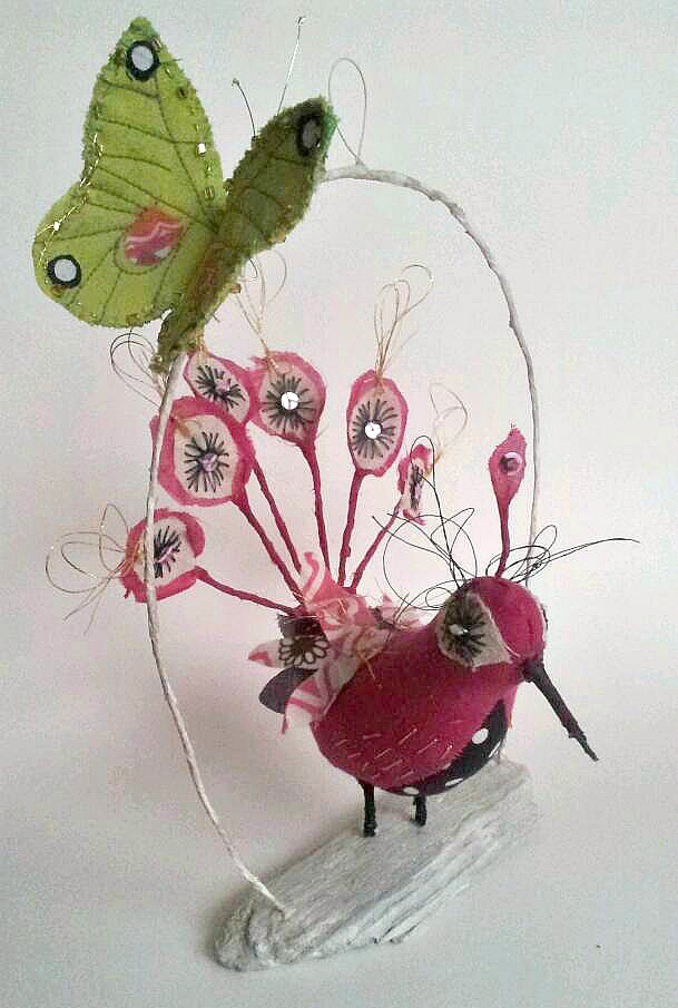 Rare pink peacock with green butterfly friend. Embroidered textile sculpture.