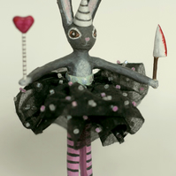 Butcher bunny with pink tights, knife and wand.