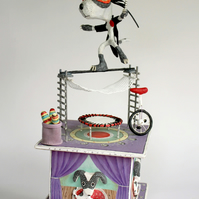 Circus dog with trampoline, unicycle & juggling bats. Mixed media box sculpture