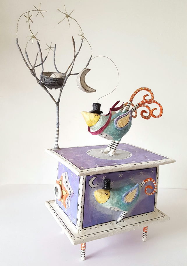 Exotic garden bird with nest, tree, silvery moon & starry sky. Box sculpture.