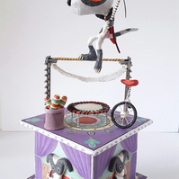 Circus paper sculpture, sculptural box with  acrobatic circus dog.