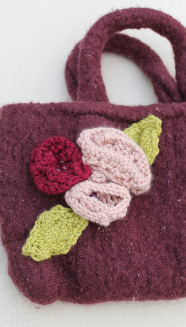 Felt red handbag with knitted flowers