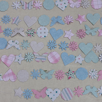 Hearts, flowers, stars and circles floral paper bunting in pink, green and blue.