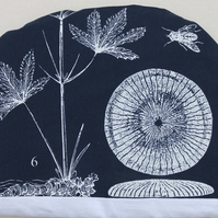 Blue print of plants and animals tea cosy