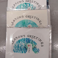 Gelli printed snowman cards with the wording ' Seasons greetings'