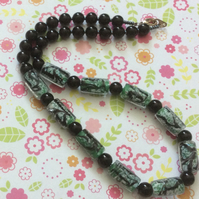 Striking all round Black and Green Glass Bead Necklace