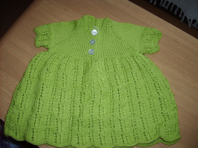 handmade knitted baby green dress