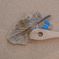 Brown leaf spoon rest with blue butterfly - ceramic gerbera leaf