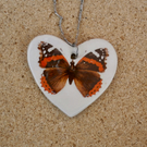 Heart pendant with butterfly on stainless steel chain, red heart, red admiral