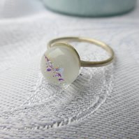 Silver ring with white dichroic glass piece