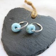 Silver hoop earring with lampwork bead - pale blue spotted