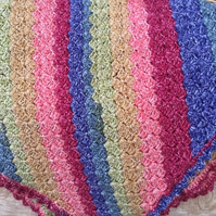 Multi coloured crochet lap blanket