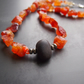 Winter Sunshine - Carnelian Necklace with Black Pebble