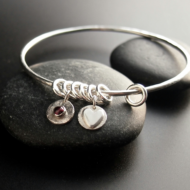 Sterling Silver Bangle with Heart Charms and Garnet