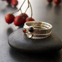 Trio of Rings in Sterling Silver with Garnet and Topaz
