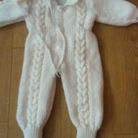 White aran onesie and bobble hat