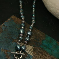 Heart pendant on pearl necklace