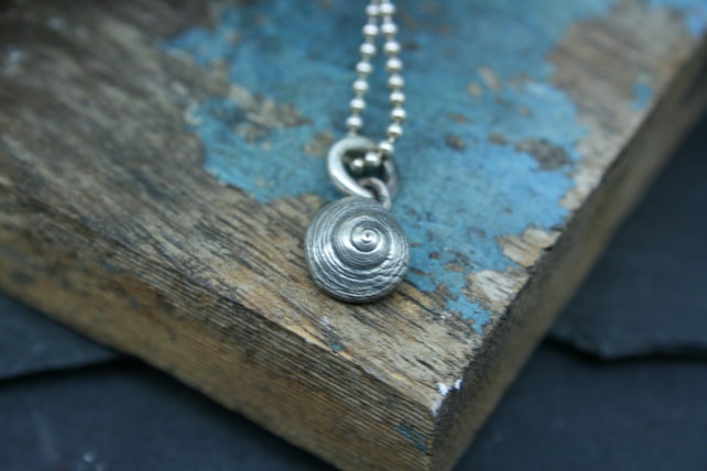 Tiny shell pendant or charm