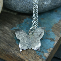 Paisley imprinted butterflysterling silver pendant