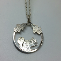 Squirrel pendant with oak leaves