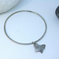 Dotty butterfly charm on round bangle