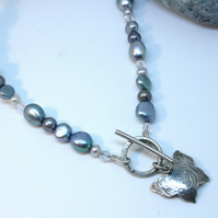 Turquoise and grey pearl T-bar necklace with butterfly pendant