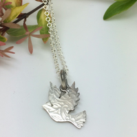 Dove charm pendant with paisley imprint
