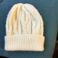 Hand knitted Aran style cable hat in cream for 4-7 years