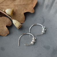 Silver hoop stud earrings with charms