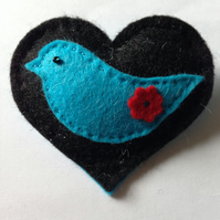 Heart with turquoise bird