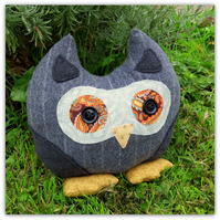 Henry, an owl doorstop, owl bookend.